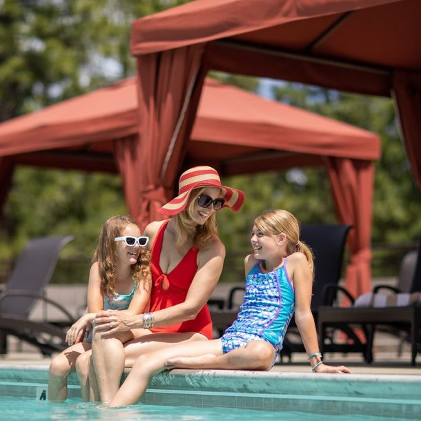 Family lounging poolside Altitude Recreation at Nakoma