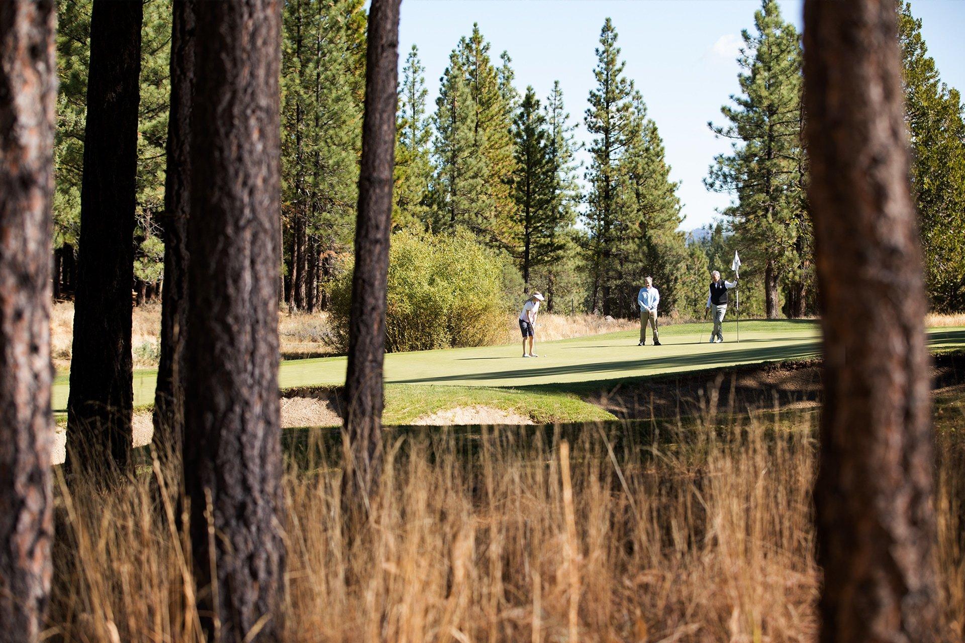 Golfers putting The Dragon Golf